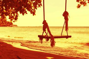 Swings on a beach