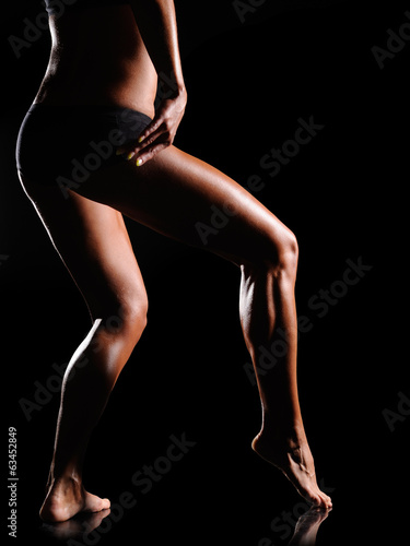 Beautiful female body on a dark background