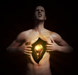 Glowing bulb inside an open chest