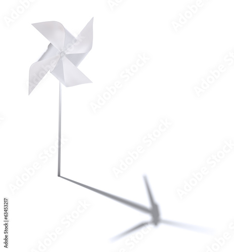 Toy windmill casting a shadow of a windturbine