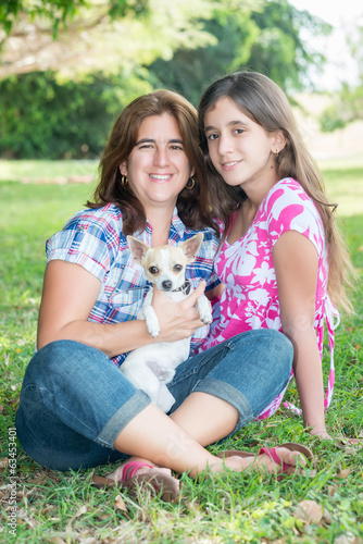 Hispanic family with their small dog at a park
