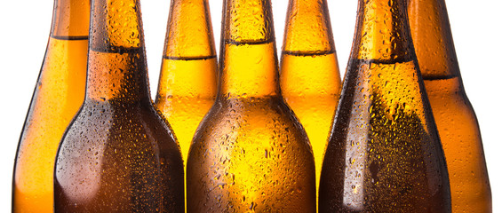 Cold beer bottle stacked on white background