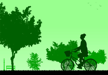Girl bike ride in park in spring silhouette