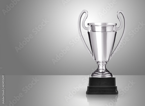 champion silver trophy over grey background
