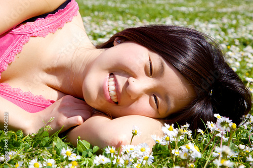 Happy chinese american girl smiling and relaxing l