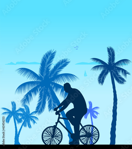 Man bike ride on the beach silhouette