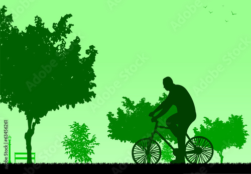 Man bike ride in park in spring silhouette