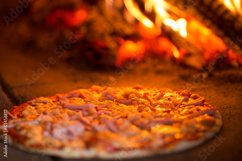 Pizza baking in oven