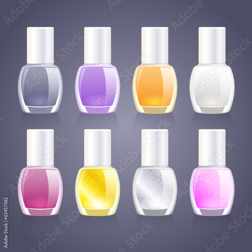 Set of assorted nail polish bottles with glitter ones.
