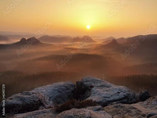 Sandstone peaks increased from fog, fog is colored to orange.