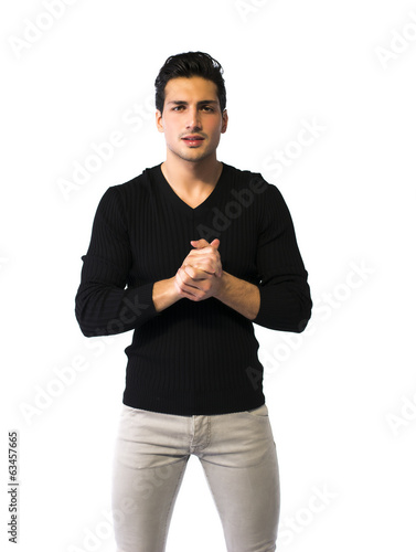 Brown eyed, black haired latin man standing on white background