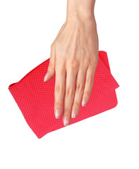 Hand wiping surface with red rag isolated on white