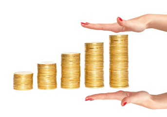 columns of gold coins and woman hands isolated on white backgrou