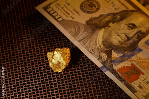 Gold and dollar bills