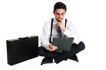 Businessman sitting on floor.