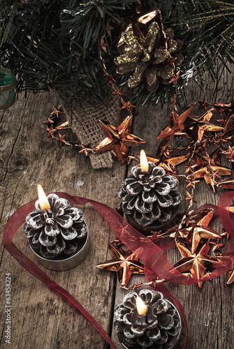 burning candles on a background of Christmas ornaments