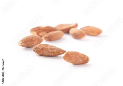 a line of almonds isolated on white