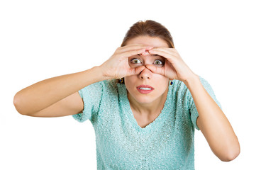 Surprised woman looking through binoculars