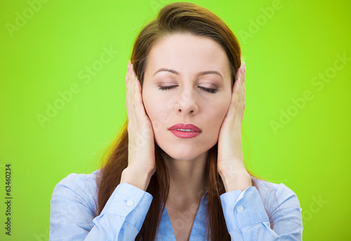 Woman covering ears, closing eyes, hear, see no evil