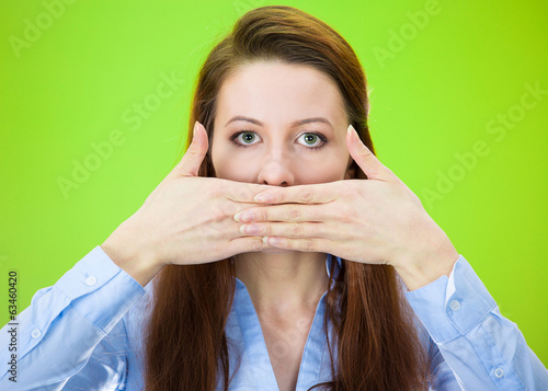 Woman covering her mouth, speak no evil concept