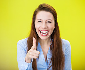 Laughing woman pointing finger at you