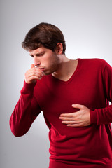 Man suffering from strong cough