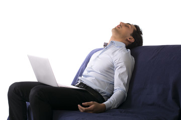 Young man fell asleep on couch white working on laptop computer