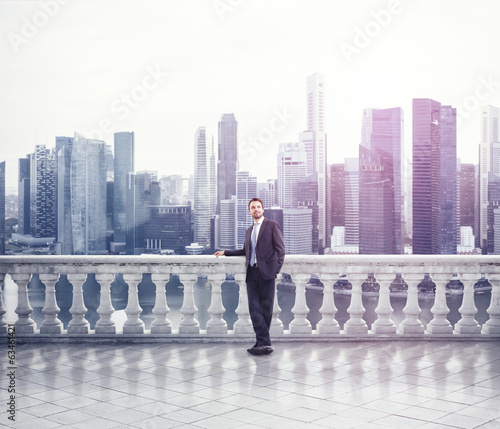 Businessman standing on a terrace