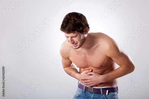 Naked man with stomachache