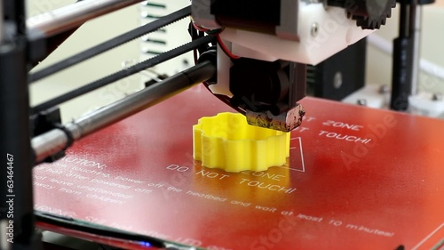 3D printer printing a yellow object
