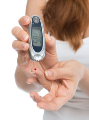 Diabetes patient measuring glucose level blood test with glucome