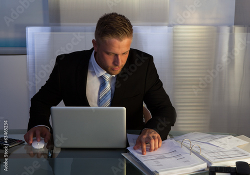 Businessman under pressure working overtime