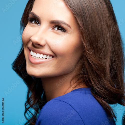 Happy smiling young woman, over blue