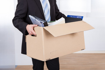 Businessman Moving Out With Cardboard Box