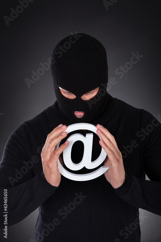Hacker with an internet domain symbol