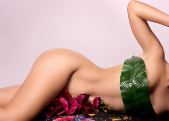 Close up of a woman beautiful body with flower