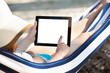 Woman Using Digital Tablet In Hammock