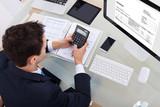 Fototapety Businessman Calculating Tax