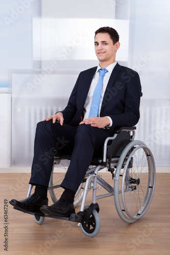 Confident Businessman Sitting On Wheelchair