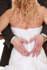 Wedding couple. Male hands making heart shape love