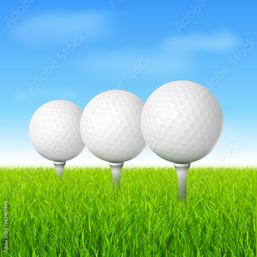 golf balls on green grass