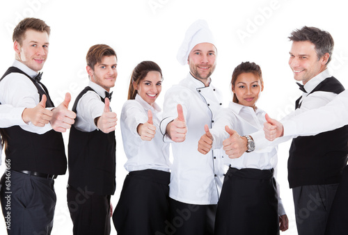 Waiters and waitresses showing thumbs up sign