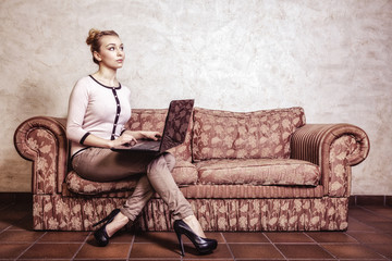 Businesswoman using computer. Internet home technology. Vintage.