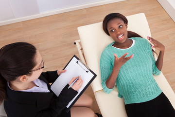 Female Patient Conversing With Psychologist