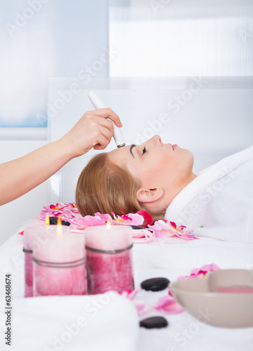Woman Getting Microdermabrasion Treatment