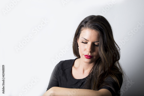 Beautiful woman with closed eyes (studio portrait)
