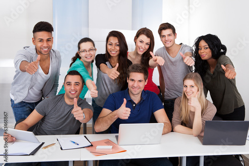 College Students Gesturing Thumbs Up Sign Together