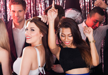 Cheerful Friends Dancing In Nightclub