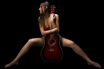 Sitting woman with guitar
