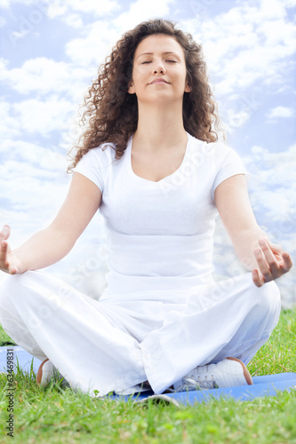 Beautiful young woman doing yoga